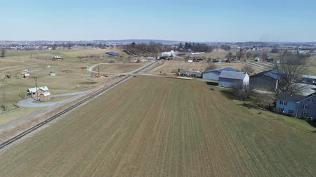 puffing : Aerial View of Amish Countryside With Steam Passenger Train Puffing Through on a Winter Day as Seen by a Drone Stock Footage
