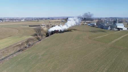 strasburg : Strasburg, Pennsylvania, February 2019 - Aerial View of Amish Countryside With Steam Passenger Train Puffing Through on a Winter Day as Seen by a Drone