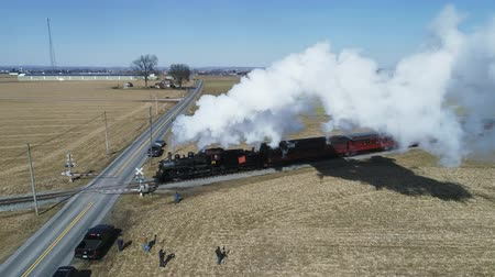 puffing : Strasburg, Pennsylvania, February 2019 - Aerial View of Amish Countryside With Steam Passenger Train Puffing Through on a Winter Day as Seen by a Drone