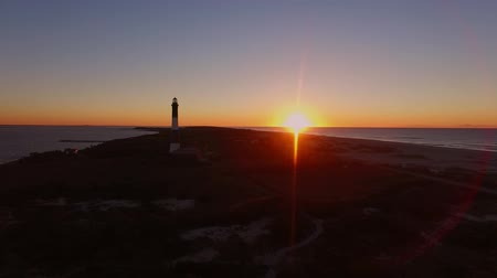 Aerial View of a Sun Rise on Long island in New York State at the Shore with a Light House as seen by a drone