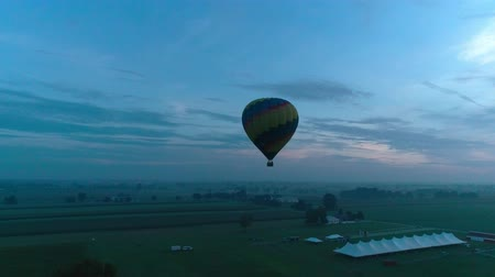 Hot Air Glow Balloons Taking Off on a Early Sunrise