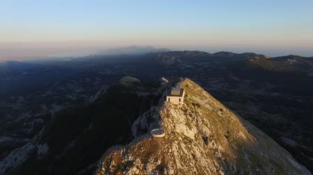 топ : aerial view of Njegos  mausoleum located on the top of the Lovcen Mountain, Montenegro.