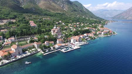 Черногория : aerial view of church in town Prcanj called Birth of Our Lady , Montenegro