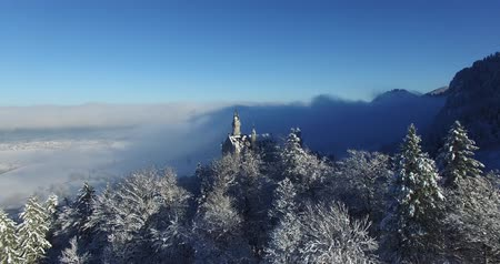 bajor : Aerial view of  Neuschwanstein Castle at sunrise in winter landscape. Germany