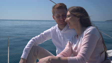 bogaty : enamored couple sitting on a yacht