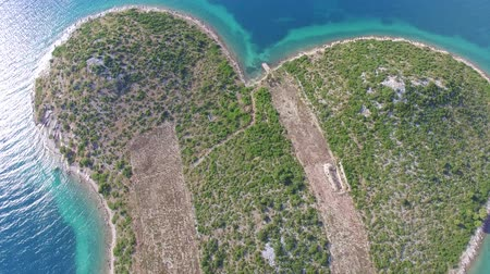 полет : Aerial view of the heart shaped Galesnjak island on the adriatic coast Стоковые видеозаписи