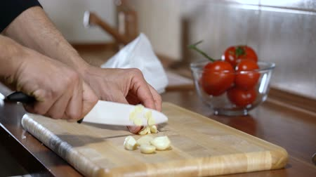 İtalyan : man chopped garlic to prepare bruschetta