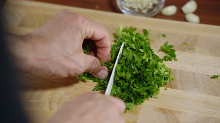 bruschetta : man cuts parsley for cooking bruschetta Stock Footage