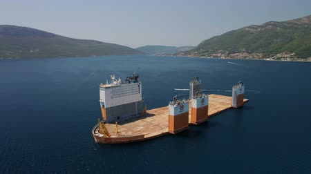 groupe : Tivat, Montenegro - 31 July 2017: Heavy lift vessel Dockwise Vanguard came to Montenegro to take the floating dock Stock Footage