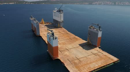 deep seaport : Tivat, Montenegro - 31 July 2017: Heavy lift vessel Dockwise Vanguard came to Montenegro to take the floating dock Stock Footage
