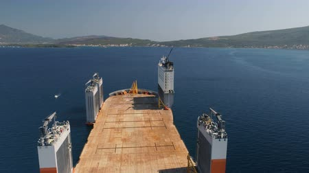 outbound : Tivat, Montenegro - 31 July 2017: Heavy lift vessel Dockwise Vanguard came to Montenegro to take the floating dock Stock Footage