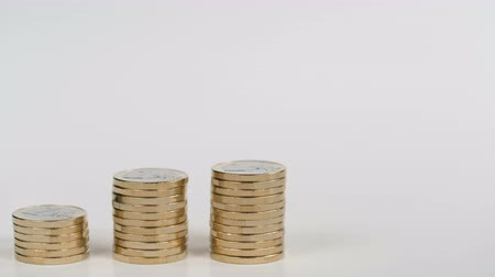 finansman : Columns of coins symbolizing the growth chart Stok Video