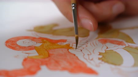 iconography : woman painter paints a religious icon