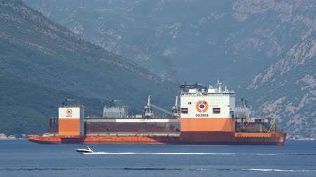 deep seaport : Tivat, Montenegro - 4 August 2017: Heavy lift vessel Dockwise Vanguard came to Montenegro to take the floating dock Stock Footage