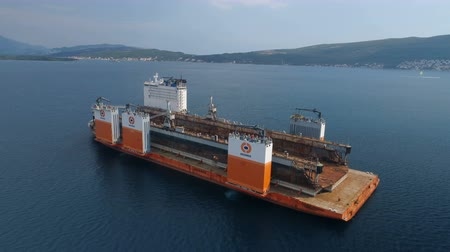 outbound : Tivat, Montenegro - 4 August 2017: Heavy lift vessel Dockwise Vanguard came to Montenegro to take the floating dock Stock Footage