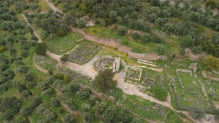 aerial athens : Aerial view of archaeological site of ancient Delphi, site of temple of Apollo and the Oracle, Greece Stock Footage