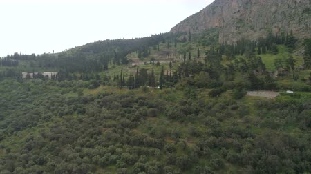 pilares : Aerial view of archaeological site of ancient Delphi, site of temple of Apollo and the Oracle, Greece Stock Footage