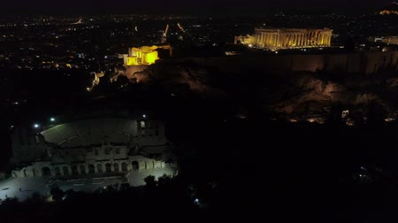 aerial athens : Aerial night video of iconic ancient Acropolis hill and the Parthenon at night, Athens historic center