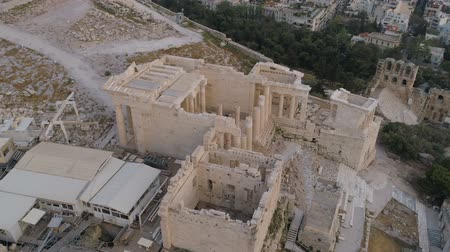 aerial athens : Aerial view of Propylaea Gate in Acropolis of Athens ancient citadel in Greece Stock Footage
