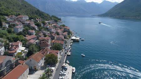 балканский : Aerial view of St. Nicholas Church in Perast, Kotor Bay. Стоковые видеозаписи