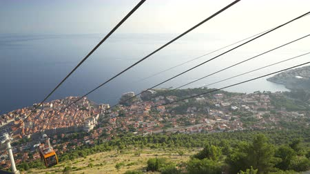 크로아티아 : View Of Old City Dubrovnik Cable Car Passing By Sunset Travel Tourism Happiness Vacation Concept