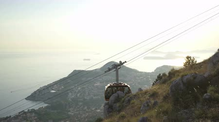 dalmata : View Of Old City Dubrovnik Cable Car Passing By Sunset Travel Tourism Happiness Vacation Concept
