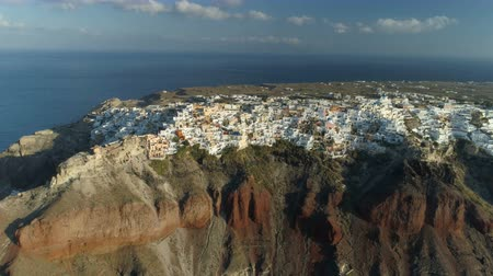 pan shot : Aerial view flying over city of Oia on Santorini Greece