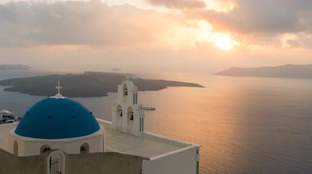 yunan : sunset over aegean sea with view to Virgin Mary Catholic Church Three Bells of Fira