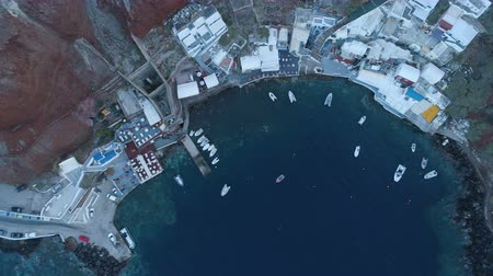 УВР : Aerial view of Ammoudi pier in Oia city on Santorini Greece