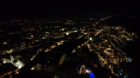 Санторини : Aerial view of famous Greek resort Thira at night.