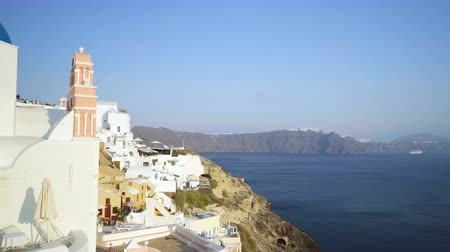 УВР : Panning view of blue dome churches and Caldera in Santorini Island, Greece