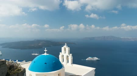 virgem : aegean sea with view to Virgin Mary Catholic Church Three Bells of Fira, Santorini.