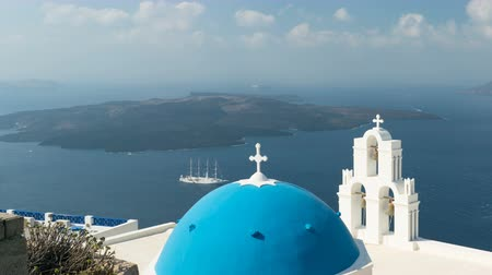 vergine maria : aegean sea with view to Virgin Mary Catholic Church Three Bells of Fira, Santorini.