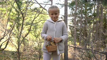 learning to walk : Adorable little girl picking mushrooms in the forest