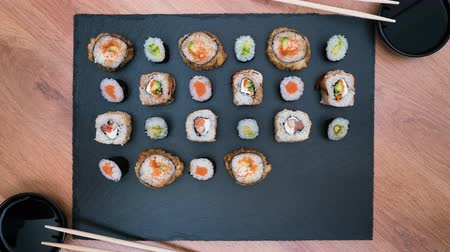 soy : sushi rolls appear and disappear on a dish