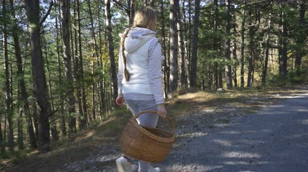 a genoux : woman carrying a basket of mushrooms