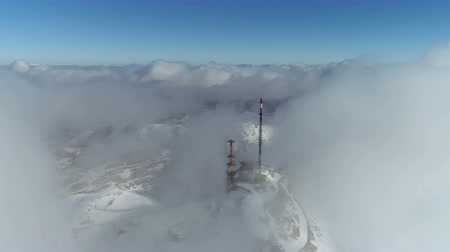 rüzgârla oluşan kar yığını : Stunning mountain winter landscape of Stirovnik peak with telecommunication tower, the highest summit of the Lovcen National Park.