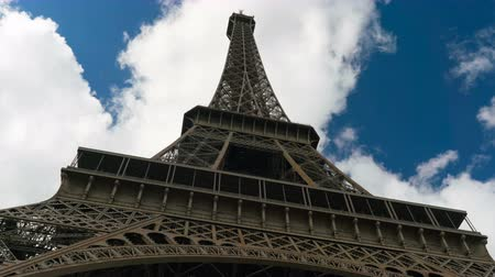 eiffel : Eiffel tower blue sky with clouds down to top view hyperlapse