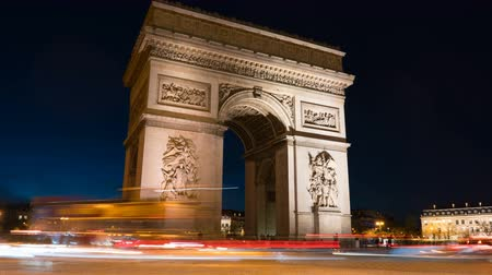 french metro : Arc de Triomph in Paris by night. This historical monument overlooks the avenue des champs elysees in the heart of French capital.