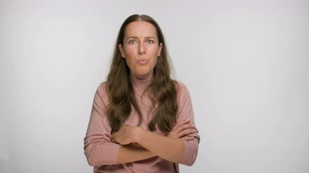 resentment : shocked woman spreads her arms to the sides and asks what