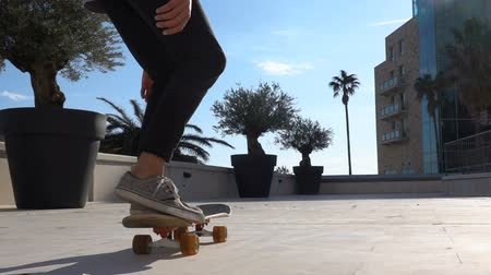 bruslení : Close up of skater skateboarder man doing 360 kickflip heelflip flip trick in slow motion jump