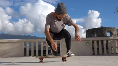 kickflip : Close up of skater skateboarder man doing 360 kickflip heelflip flip trick in slow motion jump