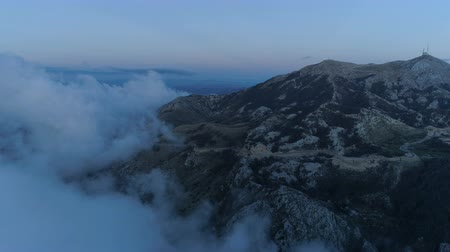 lovcen : flying above the clouds after sunset