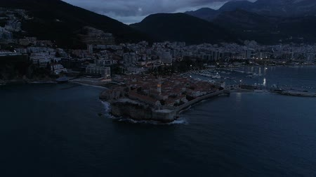 residencial : aerial view of coastal old town Budva with medieval buildings at dusk