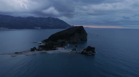 historical : aerial view of Sveti Nikola island near Budva town at dusk