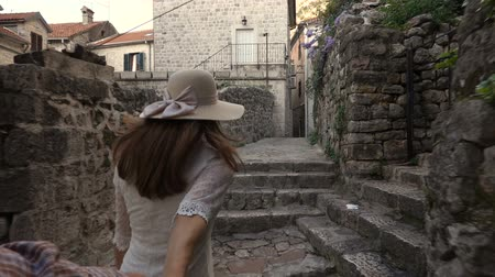 estreito : Young Woman Leading a Man to the Adventure in an Old European Town. Stock Footage