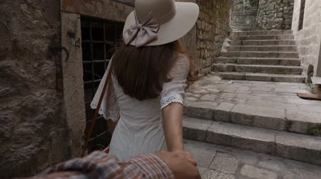 historical : Young Woman Leading a Man to the Adventure in an Old European Town. Stock Footage