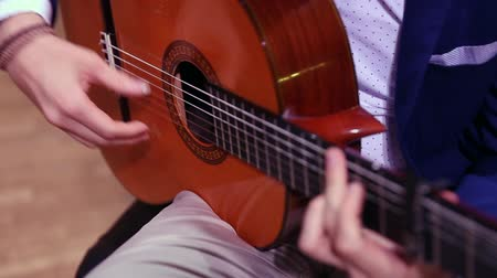 flamenco : Close-up of musician hands playing classical spanish acoustic guitar. Focus on hand.