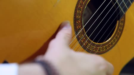 flamenco : Close-up of musician tuning and playing a classical spanish acoustic guitar. Stock Footage