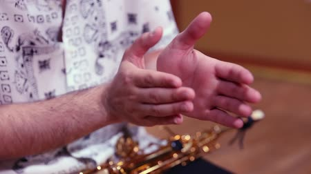 flamenco : Close-up of musician hands clapping rhythmically on stage Stock Footage